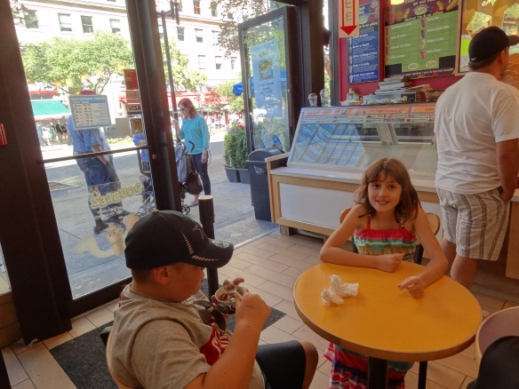 Both kids at Ben and Jerry's in late afternoon