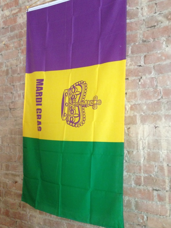 The Café Mardi Gras flag